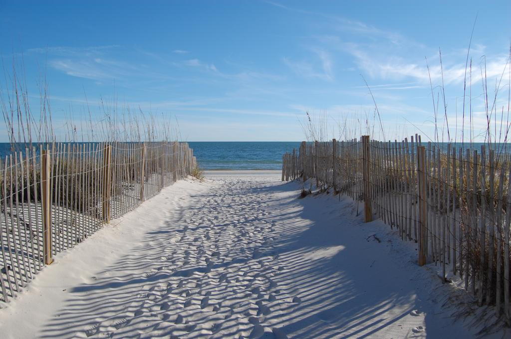 sand walkway to Gulf of Mexico outside Sandpiper condominiums