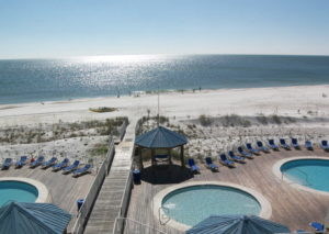 view of beach access and three pools